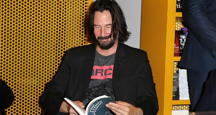 Keanu Reeves reading books